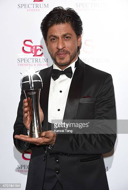 Shah Rukh Khan with his award for Outstanding Achievement in Cinema during The Asian Awards 2015 at The Grosvenor House Hotel on April 17 2015 in...