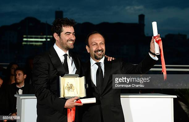 Shahab Hosseini poses with the award for Best Actor for the movie 'The Salesman' and director Asghar Farhadi poses with his award for the Best...
