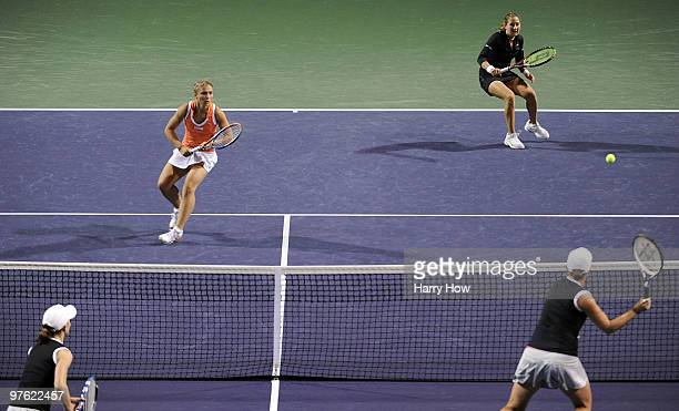 Shahar Pe'er of Israel and Sara Errani of Italy compete in their match against Cara Black of Zimbabwe and Liezel Huber of the United States during...