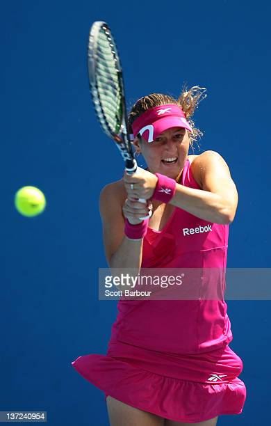 Shahar Peer of Israel plays a backhand in her first round match against Isabella Holland of Australia during day two of the 2012 Australian Open at...