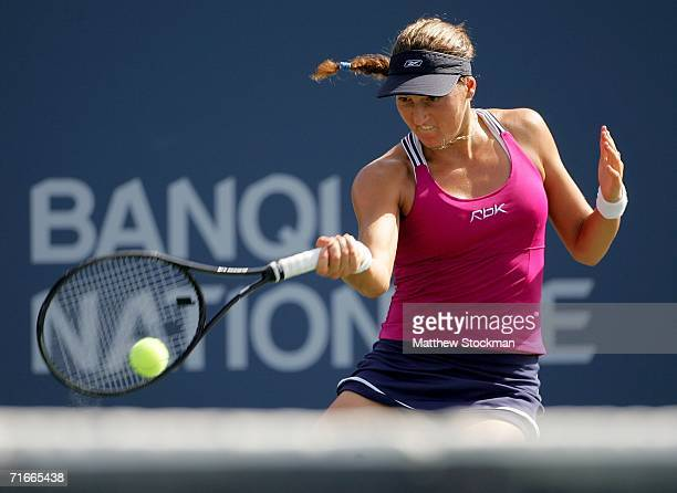 Shahar Peer of Israel returns a shot to Marion Bartoli of France during the Coupe Rogers at Stade Uniprix August 17, 2006 in Montreal, Canada.