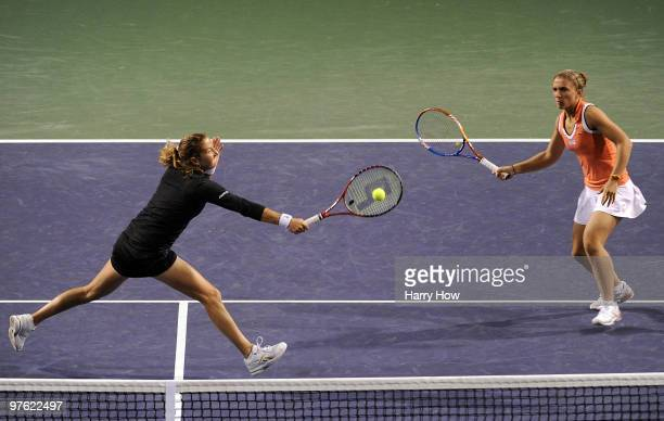 Shahar Pe'er of Israel stretches for a volley in front of Sara Errani of Italy in their match against Cara Black of Zimbabwe and Liezel Huber of the...