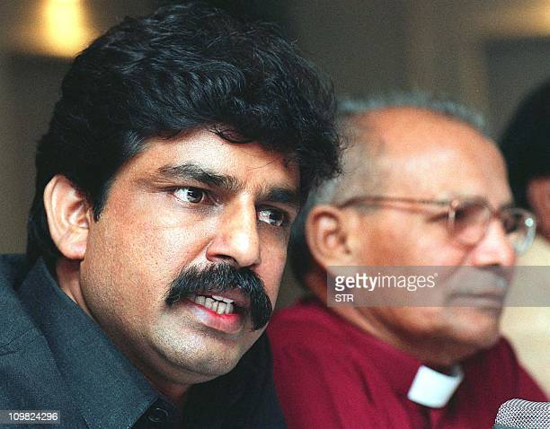 Shahbaz Bhatti a Christian rights leader and head of All Pakistan Minorties Alliance flanked by Bishop John Victor Mall addresses a press conference...
