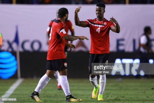 Shahdon Winchester of Trinidad Tobago celebrates with teammates after scoring the first goal of his team during the match between Mexico and Trinidad...