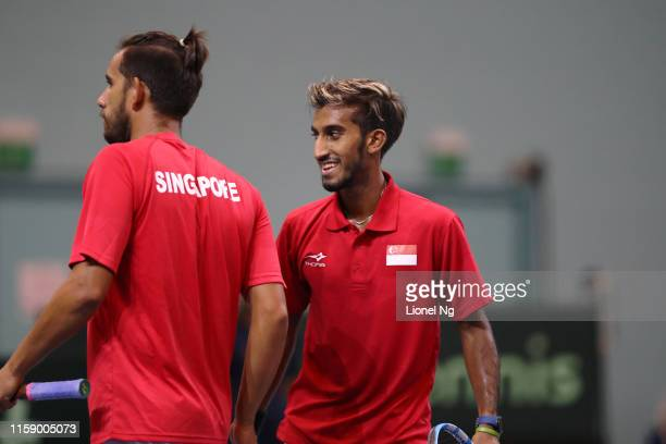 Shaheed Alam and Roy Hobbs of Singapore in action during their mens doubles playoff match against Shahin Khaledan and Kiarash Souri of Iran during...