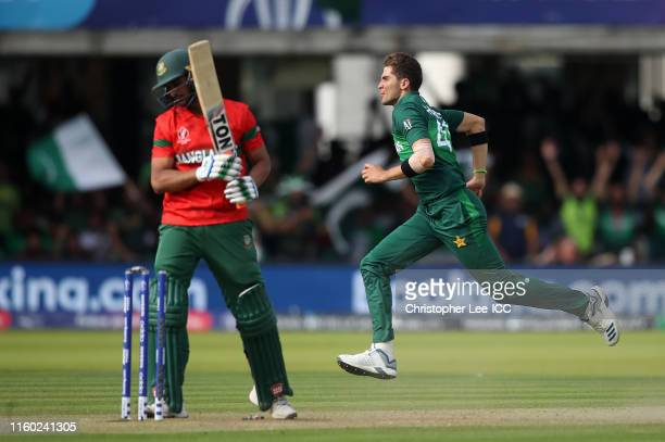 Shaheen Afridi of Pakistan celebrates after taking the wicket of Mahmudullah of Bangladesh, his fifth wicket during the Group Stage match of the ICC...