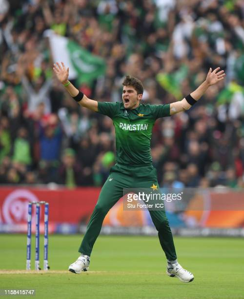Shaheen Afridi of Pakistan celebrates after taking the wicket of Tom Latham of New Zealand during the Group Stage match of the ICC Cricket World Cup...