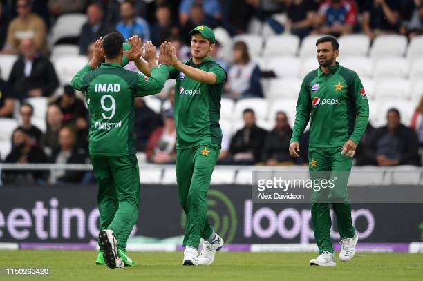 Shaheen Afridi of Pakistan celebrates the wicket of Jonny Bairstow of England with Imad Wasim of Pakistan during the 5th One Day International...