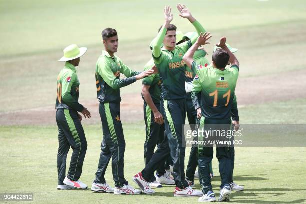 Shaheen Afridi of Pakistan celebrates with teammates for the wicket of Baheer Shah of Afghanistan during the ICC U19 Cricket World Cup match between...