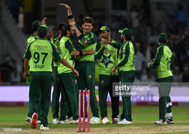 Shaheen Shah Afridi of Pakistan celebrates with team mates after taking the final wicket during the first Vitality International T20 match between...
