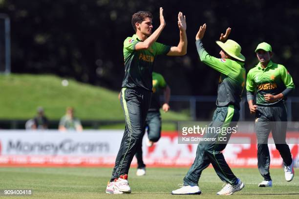 Shaheen Shah Afridi of Pakistan is congratulated by team mates after dismissing Matthew Breetzke of South Africa during the ICC U19 Cricket World Cup...