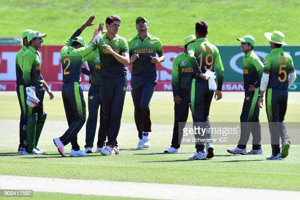 Shaheen Shah Afridi of Pakistan is congratulated by team mates after dismissing Jiveshan Pillay of South Africa during the ICC U19 Cricket World Cup...