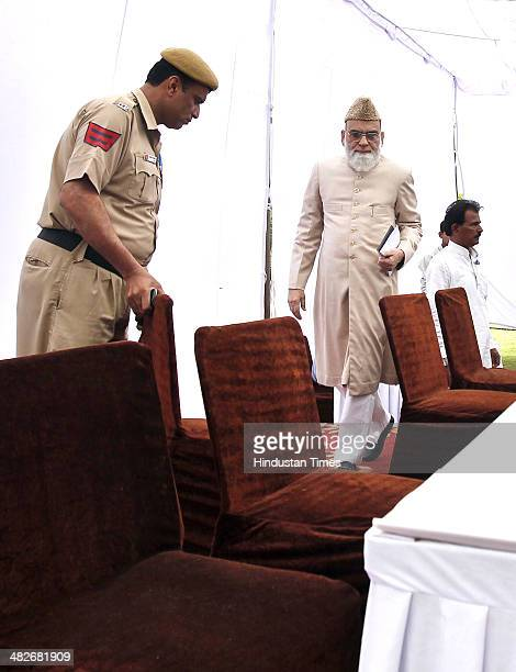 Shahi Imam of Delhi Jama Masjid Syed Bukhari arrives to announce his support for Congress in the coming Lok Sabha elections during a press conference...