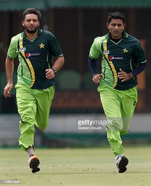 Shahid Afridi and Abdul Razzak do sprint training during a Pakistan nets session at the Punjab Cricket Association Stadium on March 28 2011 in Mohali...