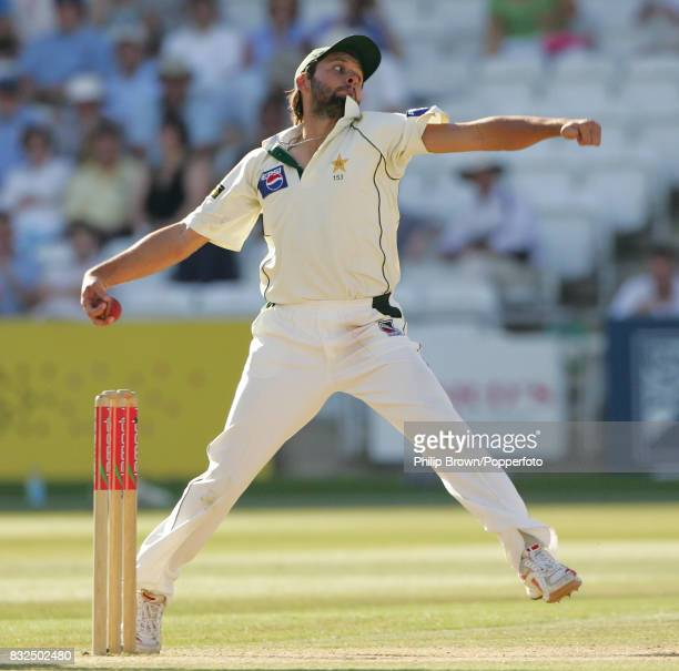 Shahid Afridi bowling for Pakistan wearing a cap during the 1st Test match between England and Pakistan at Lord's Cricket Ground London 16th July...