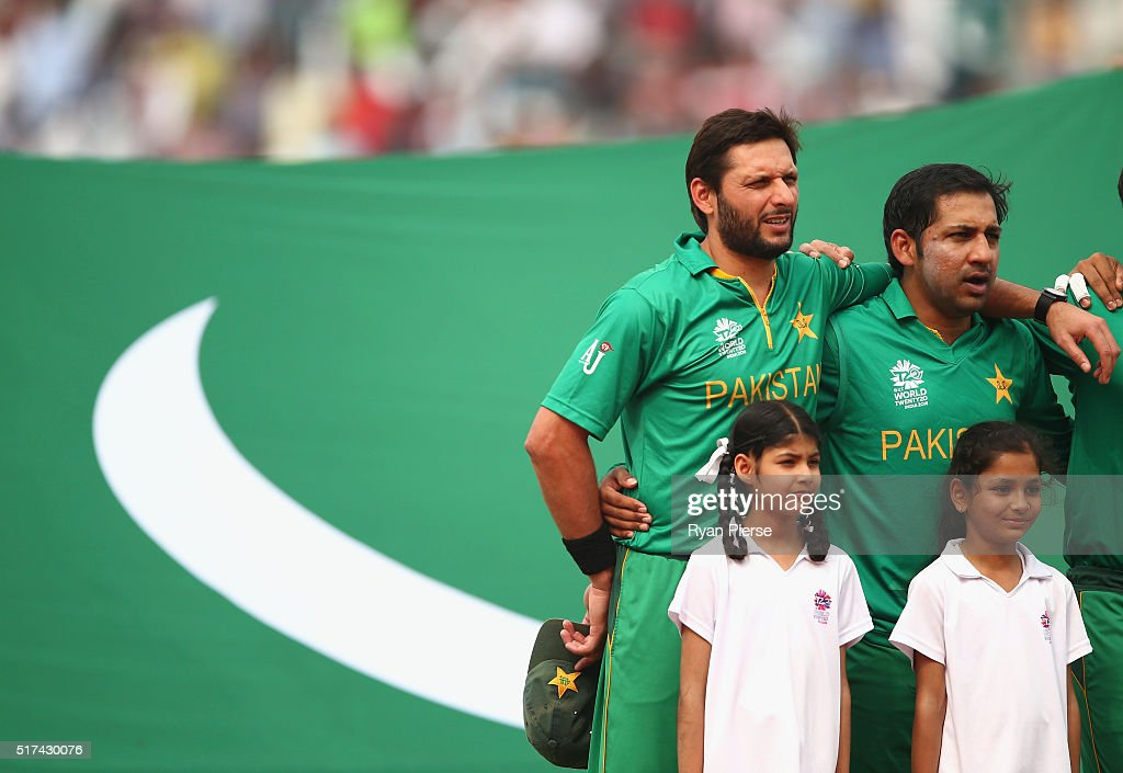 Shahid Afridi Captain of Pakistan sings the anthem during the ICC WT20 India Group 2 match between Pakistan and Australia at IS Bindra Stadium on...