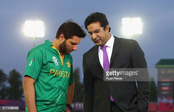 Shahid Afridi Captain of Pakistan speaks with former Pakistan cricketer Wasim Akram during the ICC WT20 India Group 2 match between Pakistan and...