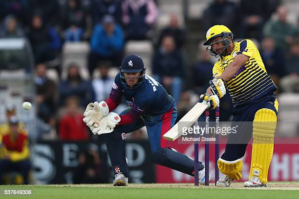 Shahid Afridi of Hampshire hits to the offside as wicketkeeper Sam Billings of Kent looks on during the NatWest T20 Blast match between Hampshire and...