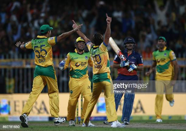 Shahid Afridi of Pakhtoons celebrate with team mates after taking a hattrick during the T10 League match between Maratha Arabians and Pakhtoons at...