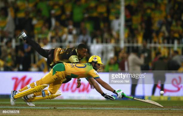 Shahid Afridi of Pakhtoons dives to make his ground during the semi final T10 match between Pakhtoons and Punjabi Legends at Sharjah Cricket Stadium...