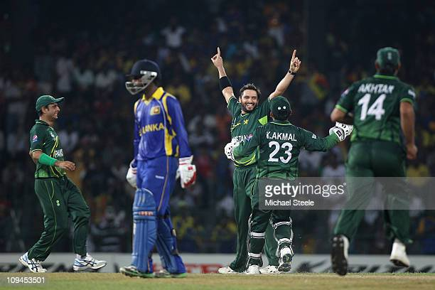 Shahid Afridi of Pakistan celebrates capturing the wicket of Kumur Sangakkara during the Pakistan v Sri Lanka 2011 ICC World Cup Group A match at the...