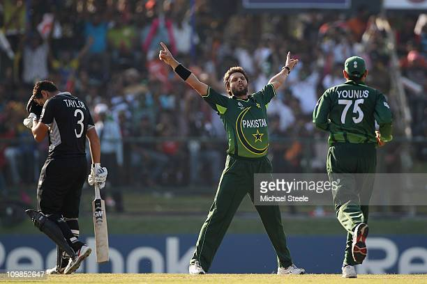 Shahid Afridi of Pakistan celebrates taking the wicket of Martin Guptill during the New Zealand v Pakistan 2011 ICC World Cup Group A match at the...