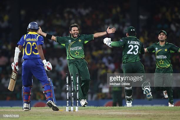 Shahid Afridi of Pakistan celebrates taking the wicket of Thilan Samaraweera stumped by Kamran Akmal during the Pakistan v Sri Lanka 2011 ICC World...