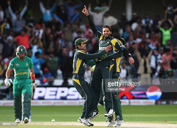 Shahid Afridi of Pakistan celebrates the wicket of Herschelle Gibbs of South Africa with team mates during the ICC World Twenty20 Semi Final between...
