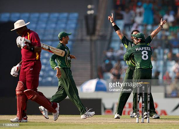 Shahid Afridi of Pakistan celebrates the wicket of Kieron Pollard of West Indies during the first ICC 2011 World Cup quarter final at ShereeBangla...