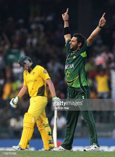 Shahid Afridi of Pakistan celebrates the wicket of Steven Smith of Australia during the 2011 ICC World Cup Group A match between Australia and...