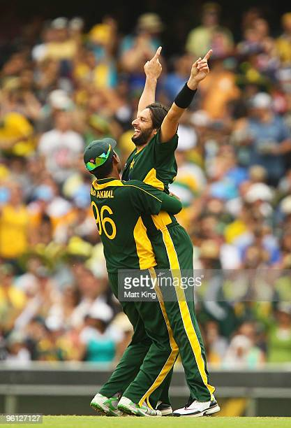 Shahid Afridi of Pakistan celebrates with Kamran Akmal after taking the wicket of Shane Watson of Australia during the second One Day International...