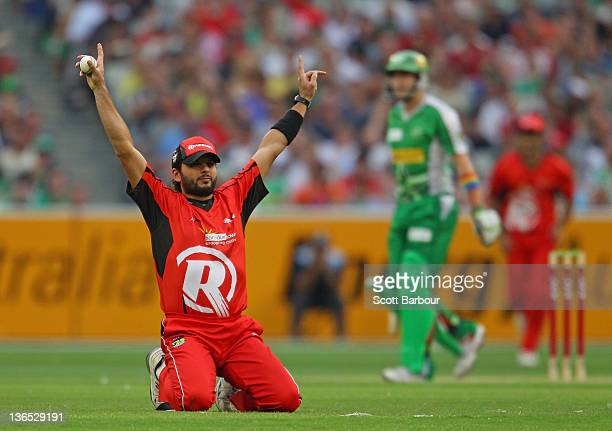 Shahid Afridi of the Renegades celebrates after taking a catch to dismiss Luke Wright of the Stars during the T20 Big Bash League match between the...