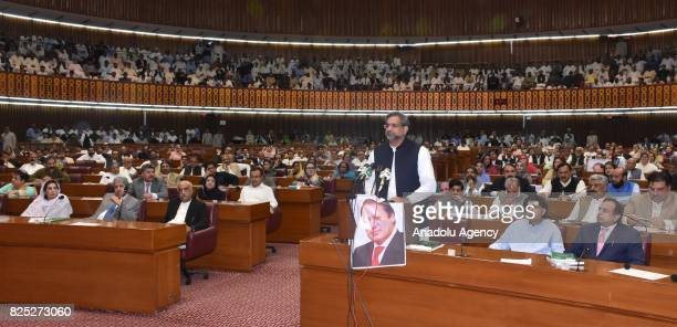 ISLAMABAD PAKISTAN AUGUST 01 Shahid Khaqan Abbasi newly elected interim Prime Minister talks to the speaker of the National Assembly in Islamabad...
