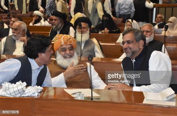 ISLAMABAD PAKISTAN AUGUST 01 Shahid Khaqan Abbasi newly elected interim Prime Minister talks with Maulana Fazal ur Rehman head of Islamic political...