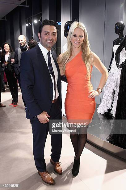 Shahin Moghadam and Sandra Schneiders attend the Unique Flagship Store Opening at the new 'Koe Bogen' on November 28 2013 in Duesseldorf Germany