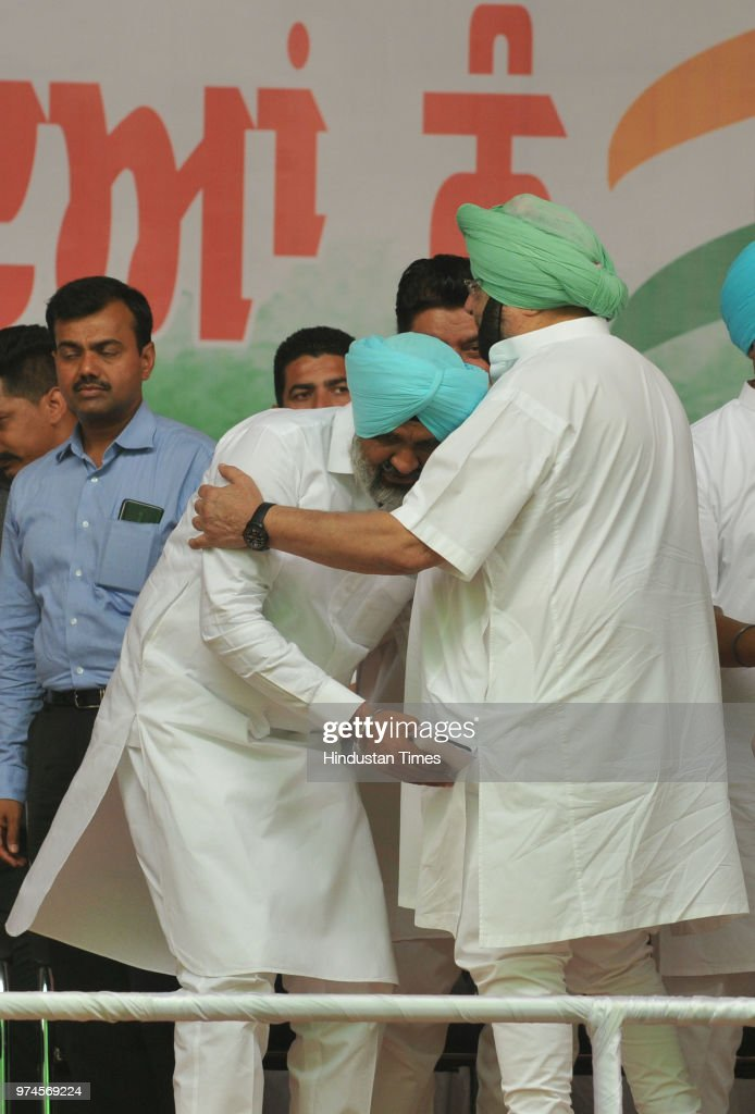 Shahkot MLA Hardev Singh Laddi seeks blessings from Punjab Chief Minister Captain Amarinder Singh at Shahkot on June 14 2018 in Jalandhar India...