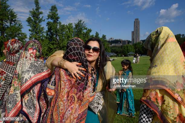Shahnila Rubab of South Fayette Pennsylvania hugs friends as they gather with fellow Muslims to for Eid alFitr a celebration marking the end of...