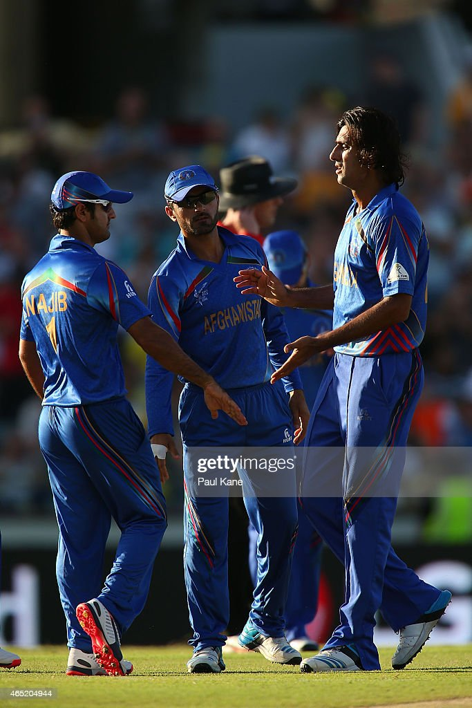 Shahpur Zadran of Afghanistan is congratulated after dismissing Steven Smith of Australia during the 2015 ICC Cricket World Cup match between Australia and Afghanistan at WACA on March 4, 2015 in Perth, Australia.