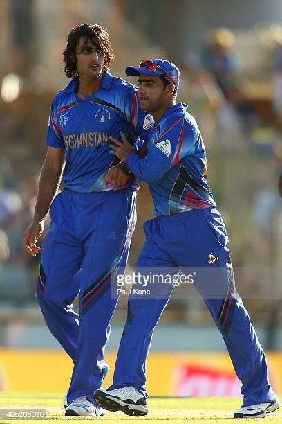 Shahpur Zadran of Afghanistan is congratulated by Usman Ghani after dismissing David Warner of Australia during the 2015 ICC Cricket World Cup match...