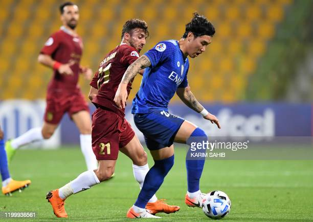 Shahr Khodro's midfielder Saeid Sadeghi vies for the ball against Hilal's defender Jang Hyun-soo during the AFC Champions League group B football...
