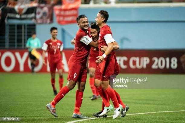 Shahril Ishak of Home United celebrates a goal with teammates Song UiYong and Faritz Hameed during the AFC Cup Zonal Semi final between Home United...
