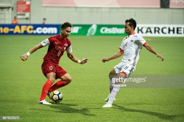 Shahril Ishak of Home United is challenged by Persija Jakarta's Novri Setiawan during the AFC Cup Zonal Semi final between Home United and Persija...