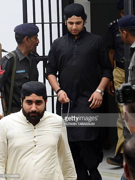 Shahrukh Jatoi arrives with his accomplice Siraj Talpur at a court before being convicted for murder in the Pakistani port city of Karachi on June 7...