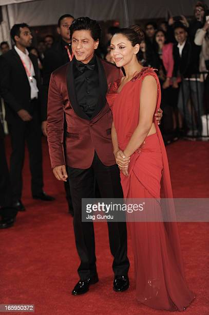 Shahrukh Khan and his Wife Gauri Khan walk the red carpet at The Times Of India Film Awardson April 6 2013 in Vancouver Canada