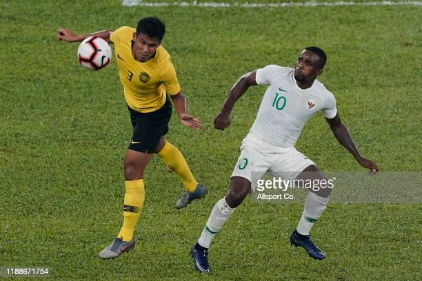 Shahrul Mohd Saad of Malaysia battles Greg Nwokolo of Indonesia during the 2022 Qatar FIFA World Cup Asian qualifier group G match between Malaysia...
