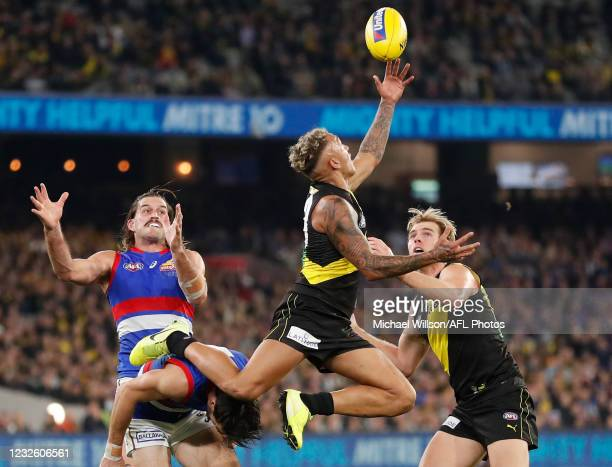 Shai Bolton of the Tigers attempts a high mark over Easton Wood of the Bulldogs during the 2021 AFL Round 07 match between the Richmond Tigers and...