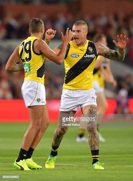 Shai Bolton of the Tigers celebrates with Dustin Martin of the Tigers during the round two AFL match between the Adelaide Crows and the Richmond...