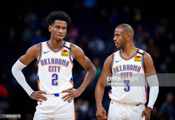 Shai Gilgeous-Alexander and Chris Paul of the Oklahoma City Thunder talk on the court against the Minnesota Timberwolves on January 13, 2020 at...