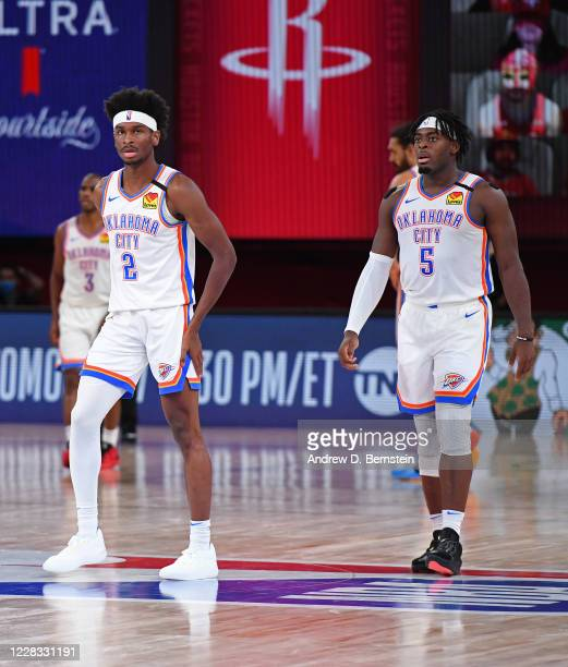Shai Gilgeous-Alexander and Luguentz Dort of the Oklahoma City Thunder looks on during Round One, Game Seven of the NBA Playoffs on September 2, 2020...