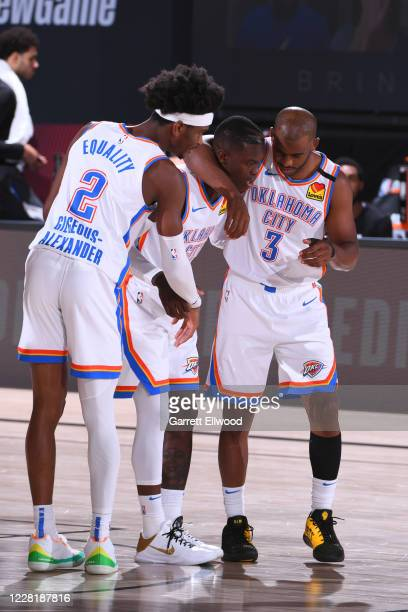Shai Gilgeous-Alexander, Dennis Schroder and Chris Paul of the Oklahoma City Thunder have a conversation during the game against the Houston Rockets...